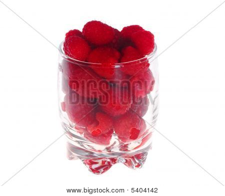 Raspberries In The Glass On White Background (isolated).