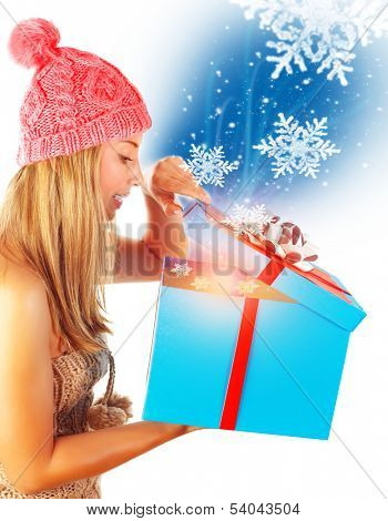 Cute woman getting Xmas gift, isolated on white background, happy facial expression, miracle on New Year eve, winter holidays concept