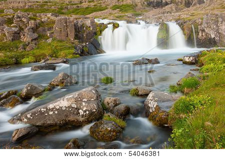 Dynjandi is the most famous waterfall of the West Fjords and one of the most beautiful waterfalls in the whole Iceland. It is actually the cascade of waterfalls