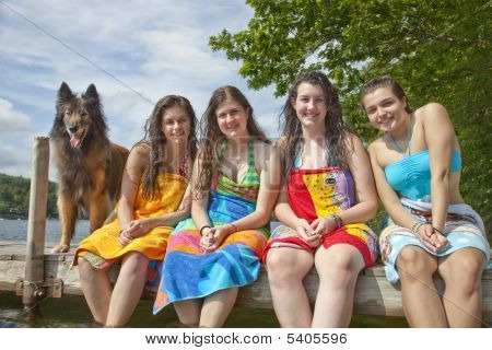Four Friends And A Dog At A Lake
