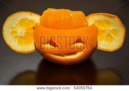 Citrus Orange Fruit Carved As A Pumpkin Face