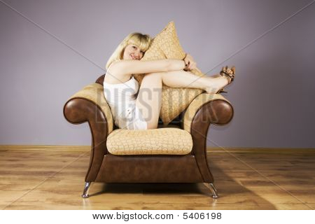 Young Woman On A Armchair