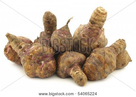 bunch of topinambur roots (helianthus tuberosus) on a white background