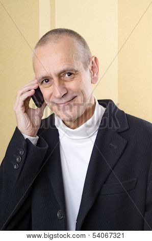 Amiable And Smiling Man On Phone