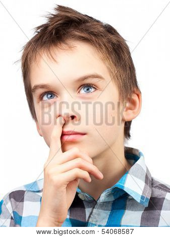 Portrait of dreamy boy picking his nose