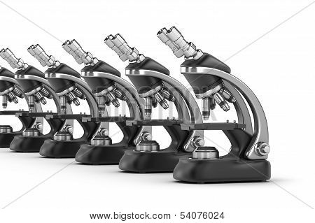 Modern scientific microscopes isolated on white