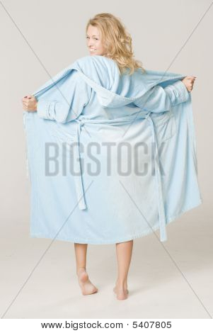 A Girl Is Dressed In A Blue Bath-house Dressing-gown