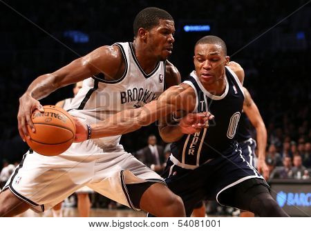 BROOKLYN, NY-DEC 4: Brooklyn Nets guard Joe Johnson (L) drives to the net as Oklahoma City Thunder point guard Russell Westbrook defends at Barclays Center on December 4, 2012 in Brooklyn, New York.