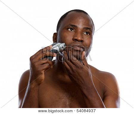 An african-american man shaving, isolated on white
