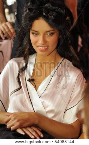 NEW YORK NY - NOVEMBER 13: Adriana Lima poses backstage at the 2013 Victoria's Secret Fashion Show