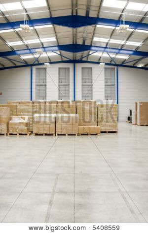 Pallets With Cartons In Warehouse interior