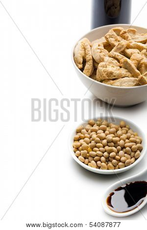 soybeans, soy meat and soy sauce on white background