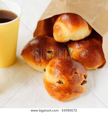 Sultana Buns In A Paper Bag With A Cup Of Coffee, Copy Space For Your Text