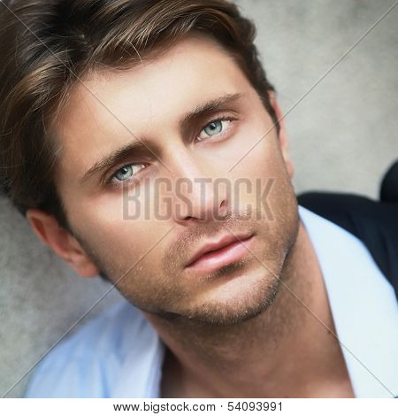portrait of young man with impressive green eyes