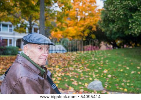 Serious Senior Male Outside With Autumn Background