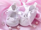 stock photo of christening  - Handmade  white baby  booties with pearls - JPG