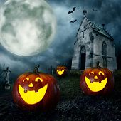 stock photo of chapels  - Halloween pumpkins and cemetery chapel at night - JPG