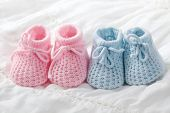 foto of booty  - Blue and pink baby booties on white background - JPG