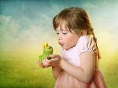 stock photo of hand kiss  - Little girl kissing a frog prince - JPG