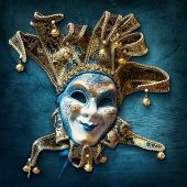 stock photo of joker  - Abstract blue background with venetian mask - JPG