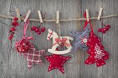 foto of clotheslines  - Christmas decoration over wooden background - JPG