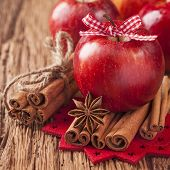stock photo of christmas spices  - Red winter apples with cinnamon sticks and anise - JPG