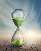 image of surrealism  - Time concept with a hourglass - JPG