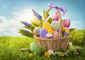 image of easter decoration  - Basket with easter eggs  on green grass - JPG
