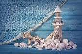 pic of fishnet  - Marine life decoration on blue shabby background - JPG