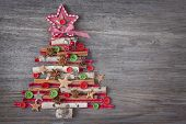 foto of christmas spices  - Christmas tree on wooden background - JPG
