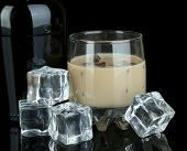 picture of bailey  - Baileys liqueur in bottle and glass isolated on black - JPG