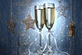 picture of champagne color  - Two glasses of champagne on bright background with lights - JPG