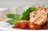 stock photo of mahi  - Plate of Mahi Mahi severd with vegetables pineapple and soy sauce.