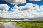 Icelandic countryside landscape in summer season. Bright summer day with nice puffy clouds. Laugarva