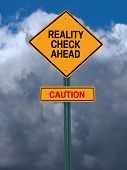 image of realism  - conceptual sign with words reality check ahead caution warning over dark blue sky - JPG