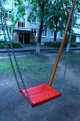image of lurch  - red swing on the chain for happy amusement - JPG