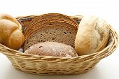 stock photo of bread rolls  - Fresh Baked Bread with Bread Rolls in Basket - JPG