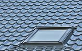 stock photo of roofs  - Roof window on a grey tiled rooftop large detailed loft skylight background diagonal roofing pattern - JPG