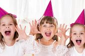 Group of adorable little girls having fun at birthday party