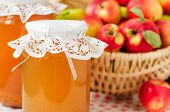 stock photo of cider apples  - Canned Apple Juice And Apples In Basket - JPG