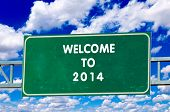stock photo of yesteryear  - Welcome to 2014 on the sign with sky in background - JPG