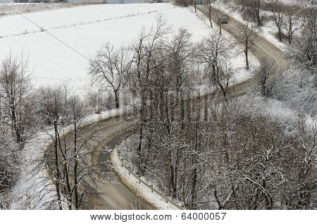 Road In Winter With Curves Seen From Distance