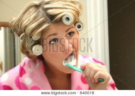 Blond Woman Brushing Teeth