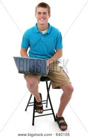 Attractive Teen Boy With Laptop