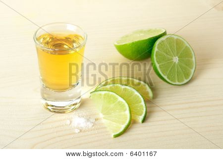 Gold Tequila With Lime Slices And Salt