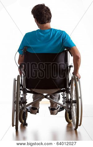 Rear View Of Handicapped Man
