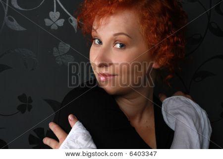 Redheaded Young Woman In Studio Near Black Wallpaper