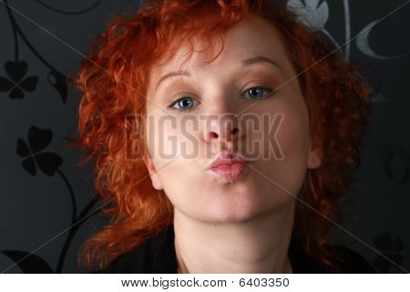 Redheaded Young Woman In Studio Near Black Wallpaper