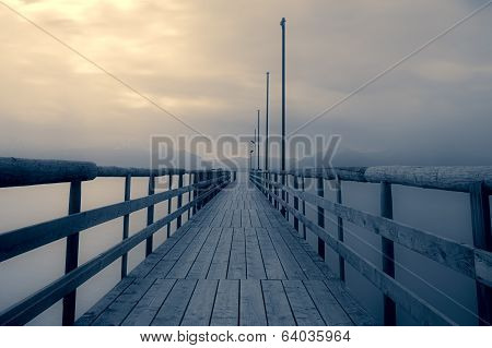 Jetty at lake Chiemsee, Bavaria, Germany, with cloudy sky