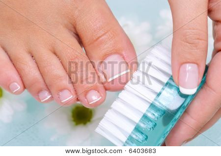 Woman Washes And Cleans The Toenails